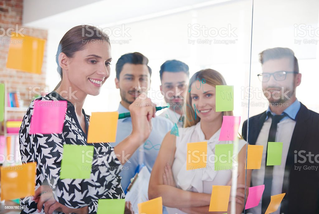 Office workers and colorful papers stock photo