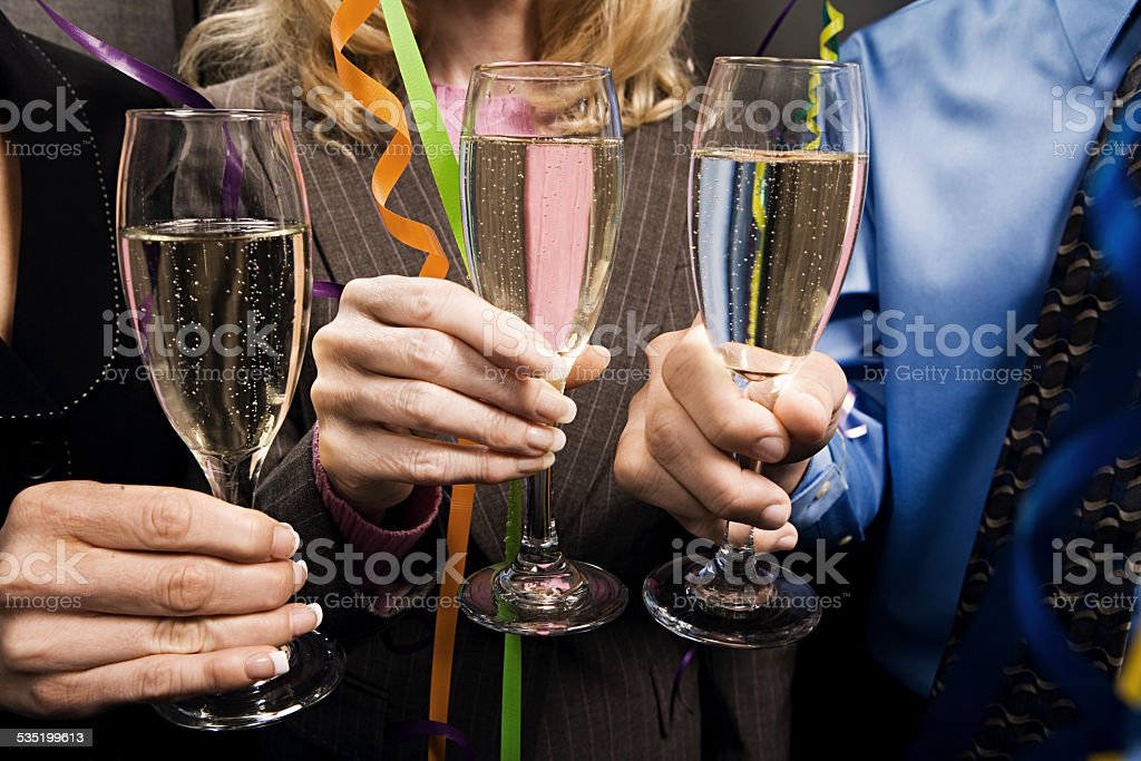 Office workers celebrating with champagne stock photo