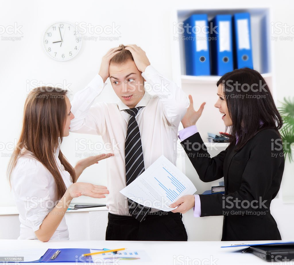 Office workers dealing with a dilemma at work royalty-free stock photo
