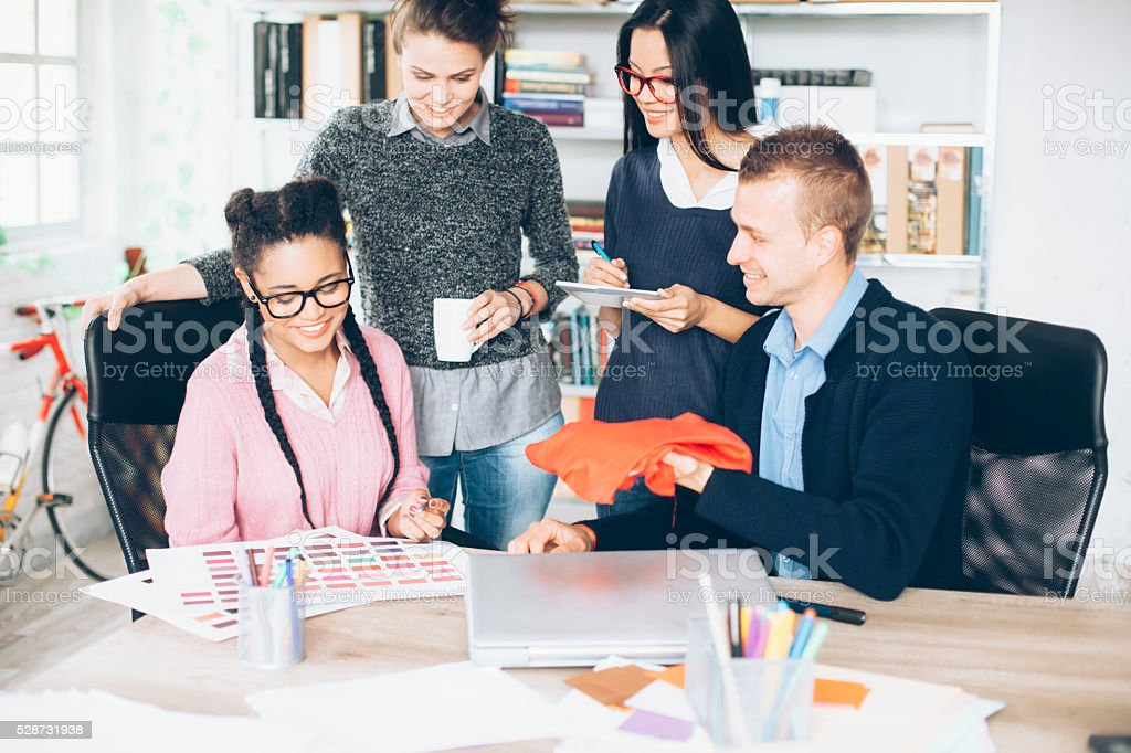 Office workers discussing creative ideas at office stock photo