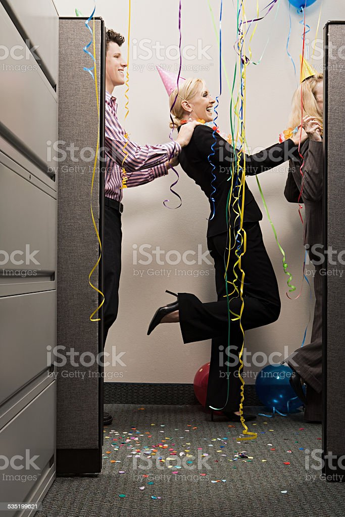 Office workers doing the conga stock photo