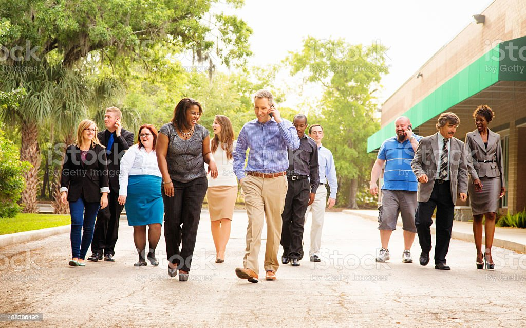 Office workers group walking from parking to work place stock photo