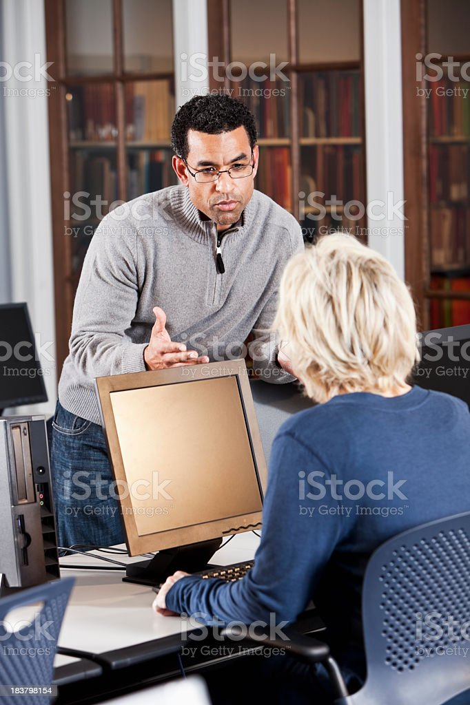 Office workers having serious discussion stock photo