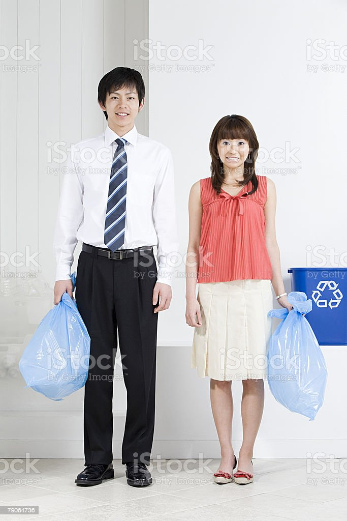 Office workers holding rubbish bags royalty-free stock photo