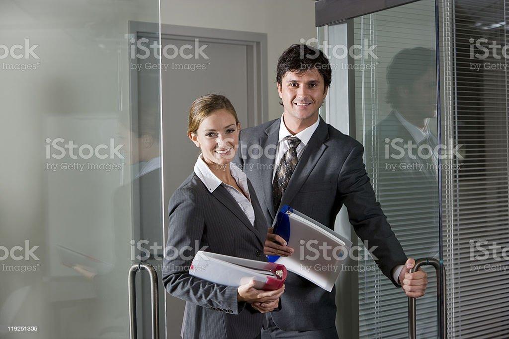 Office workers opening boardroom door stock photo