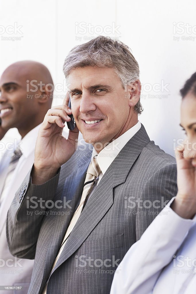 Office Workers Talking on Cellphones stock photo