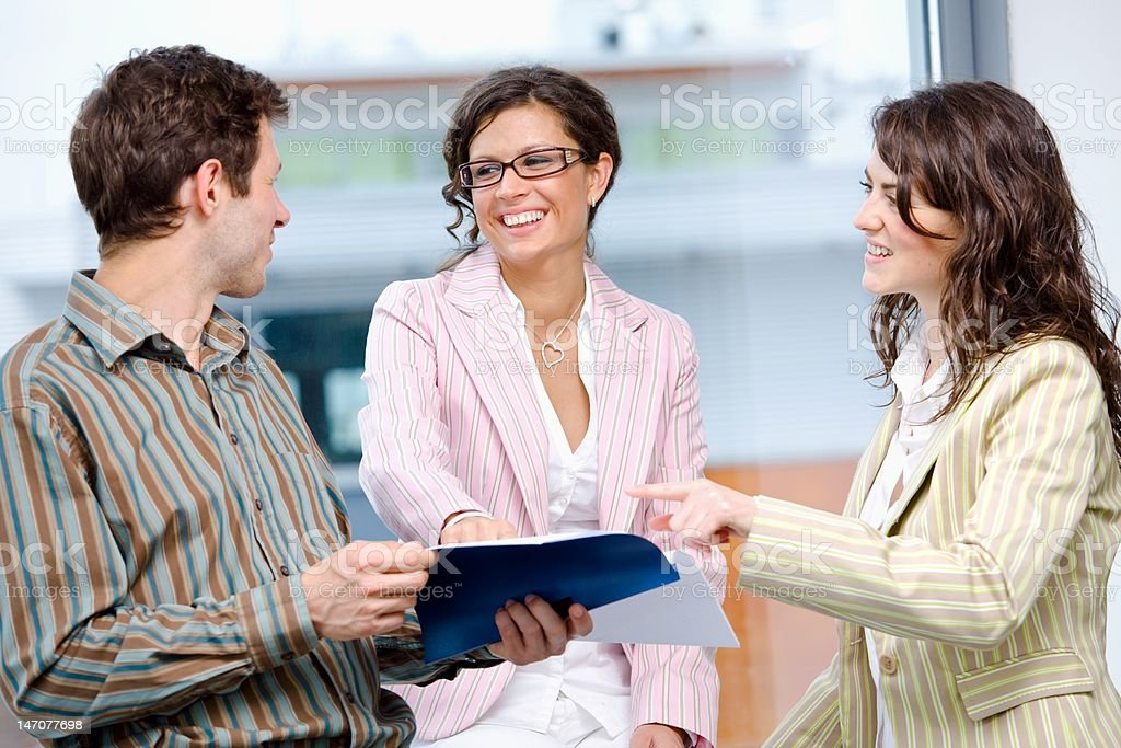 Office Workers Talking royalty-free stock photo