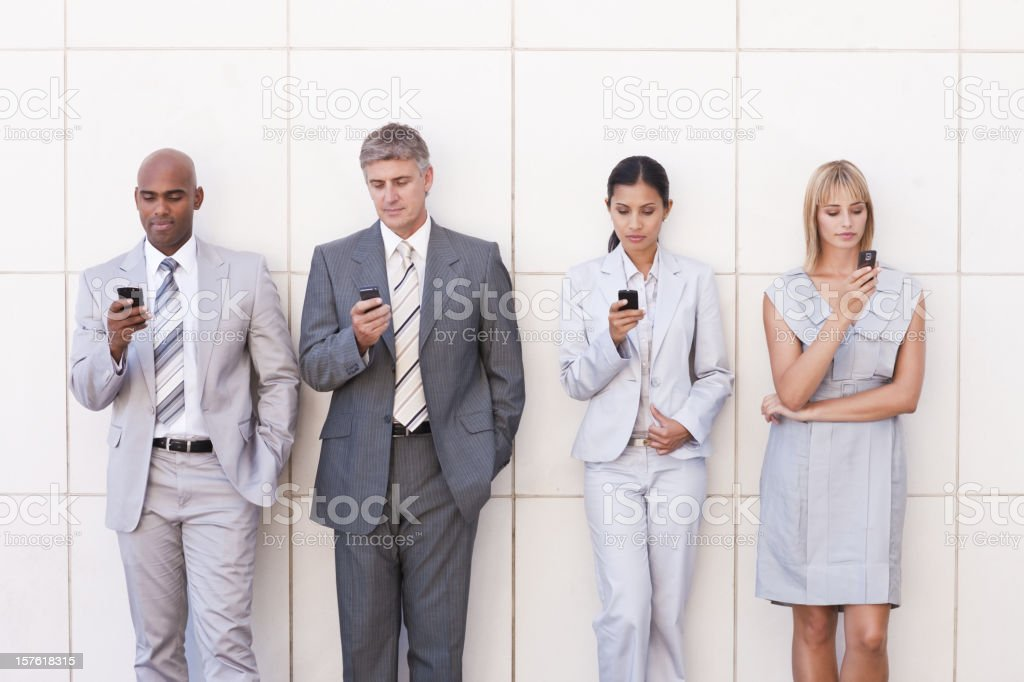 Office Workers Texting on Cellphones royalty-free stock photo