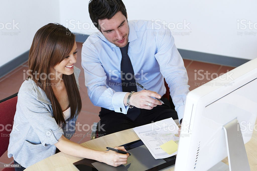 Office Workers Using a Digital Writing Tablet royalty-free stock photo