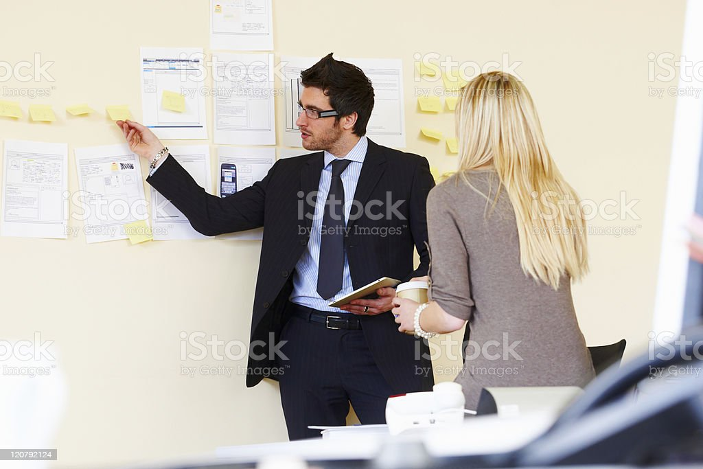 Office Workers Using Sticky Notes royalty-free stock photo
