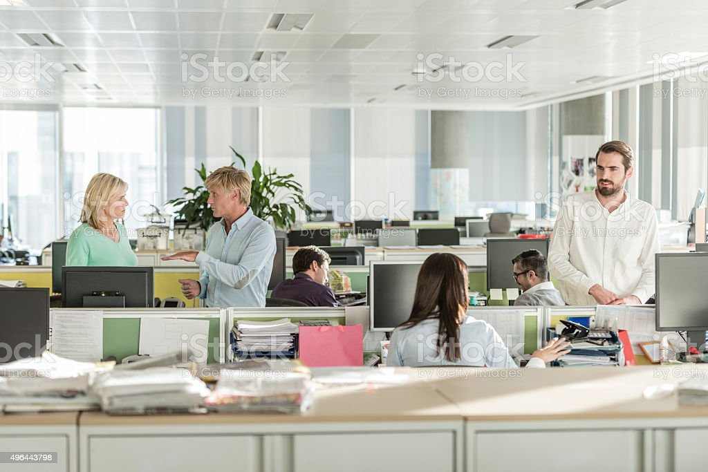 Office workers working in modern office with computers stock photo
