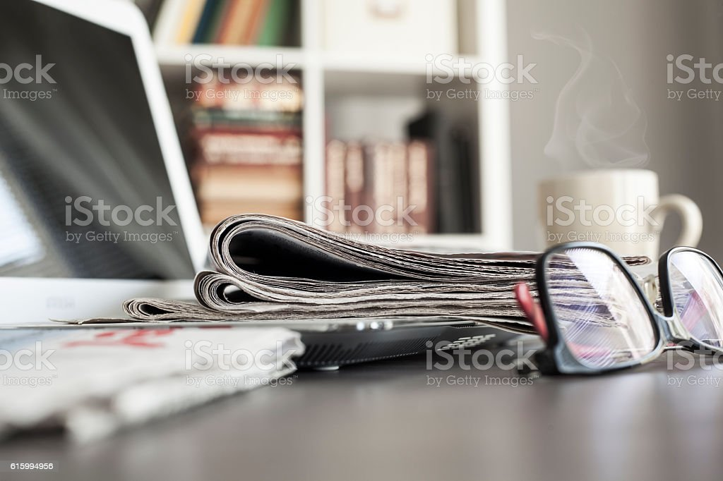 Office workplace with laptop and glasses on  table stock photo