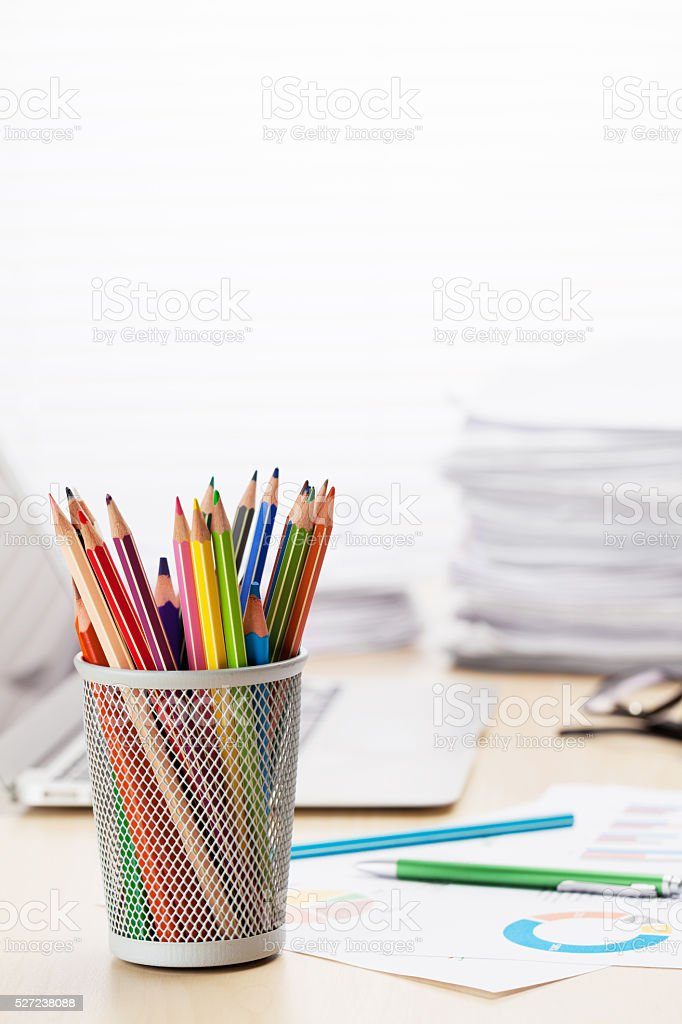 Office workplace with laptop, reports and pencils stock photo