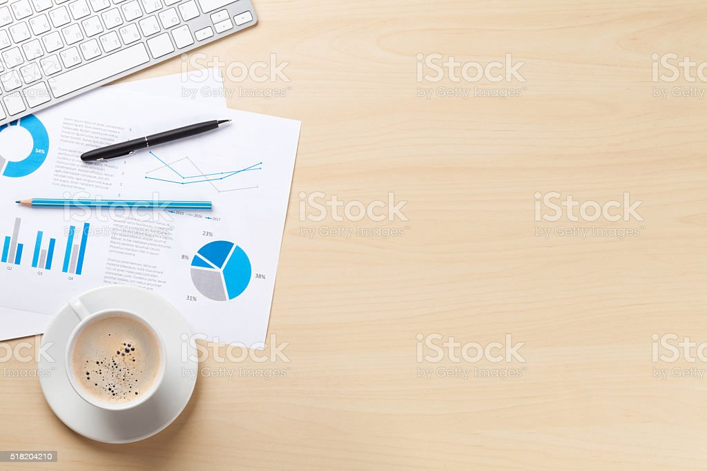 Office workplace with pc, charts and coffee stock photo