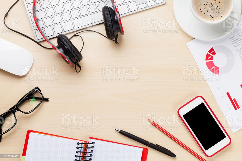 Office workplace with phone, charts and coffee stock photo