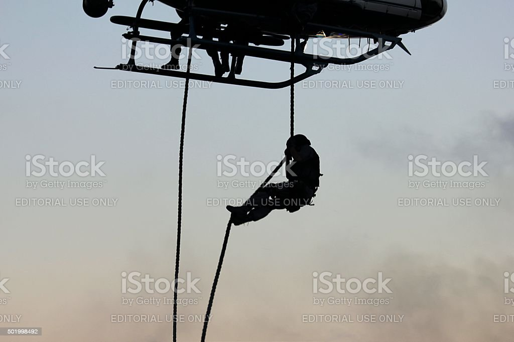 SWAT officer abseiling from a helicopter stock photo