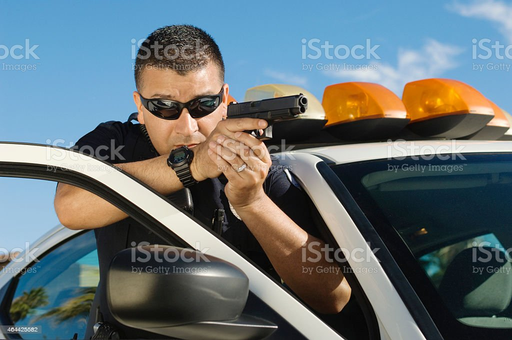 Officer Aiming With Short Gun stock photo