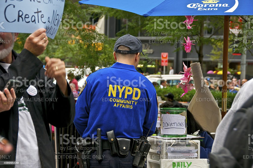 NYPD 'COMMUNITY AFFAIRS' Officer at Zuccotti Park, NYC royalty-free stock photo