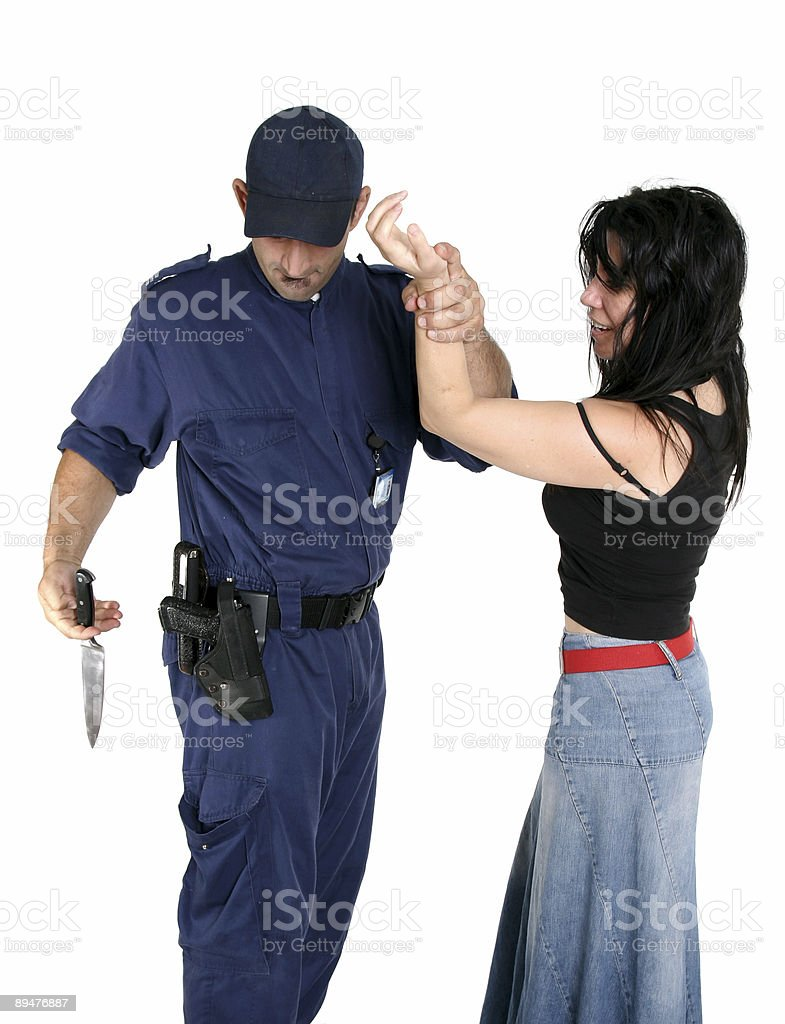 Officer disarms a weapon from suspected criminal stock photo