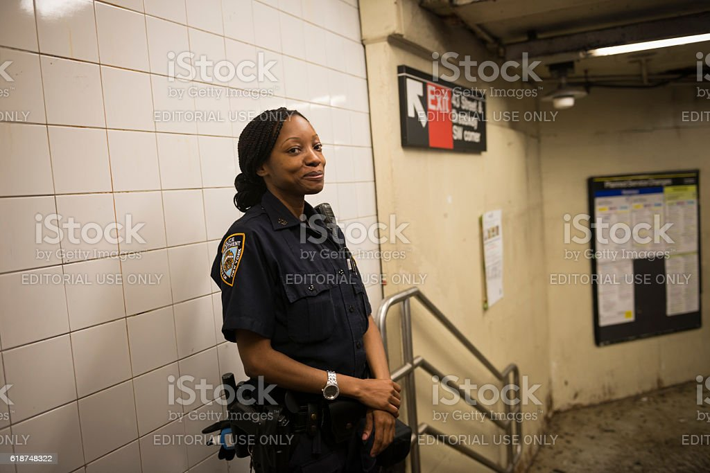 NYPD officer in Times Square subway station, New York stock photo