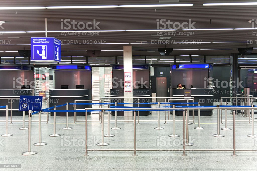 Officer is waiting at Passport Control counter for arriving pass stock photo