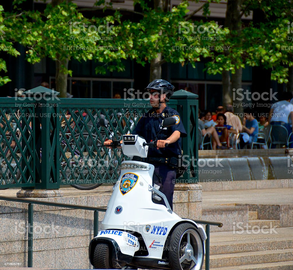 NYPD Officer on T3 Patroller Electric Scooter, Lower Manhattan, NYC royalty-free stock photo