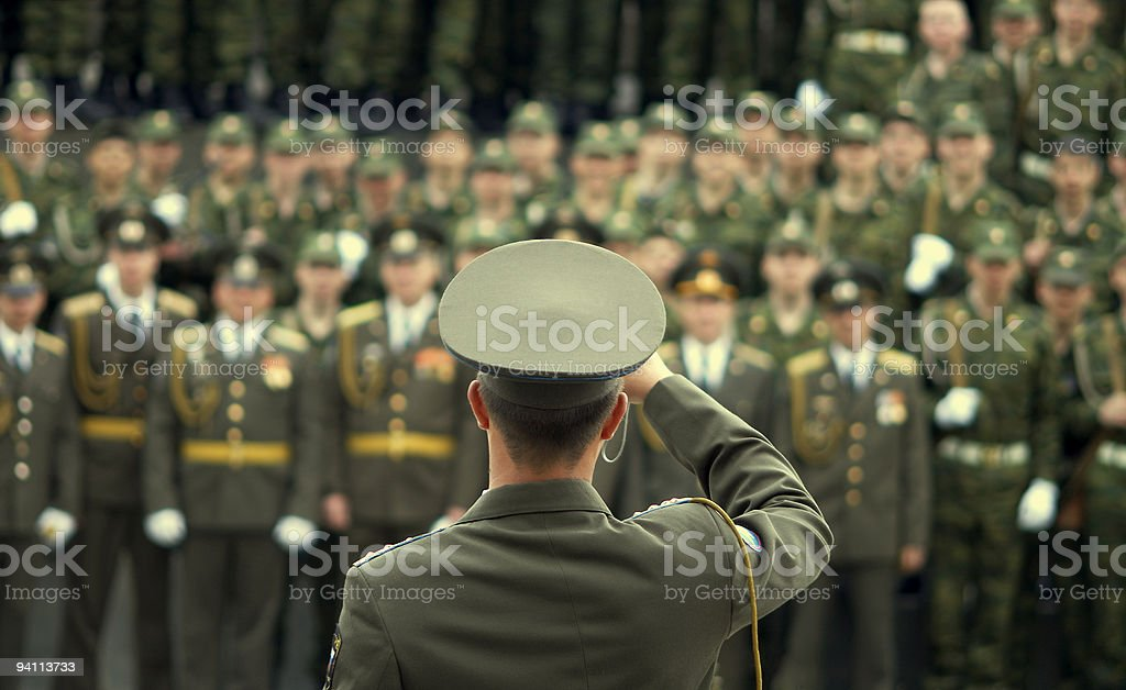 officer snap-shooting military stock photo