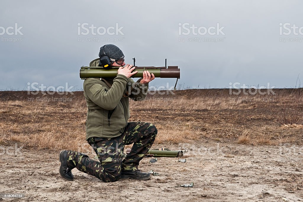 officer special operations forces shoots from a grenade launcher stock photo