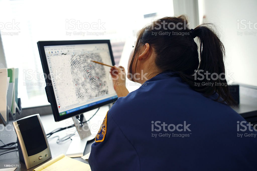Officer viewing fingerprint stock photo