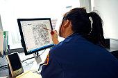 Officer viewing fingerprint
