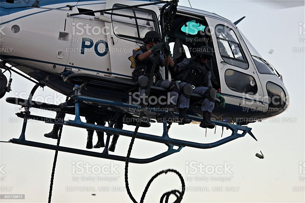 SWAT officers prepare for exit from police helicopter stock photo