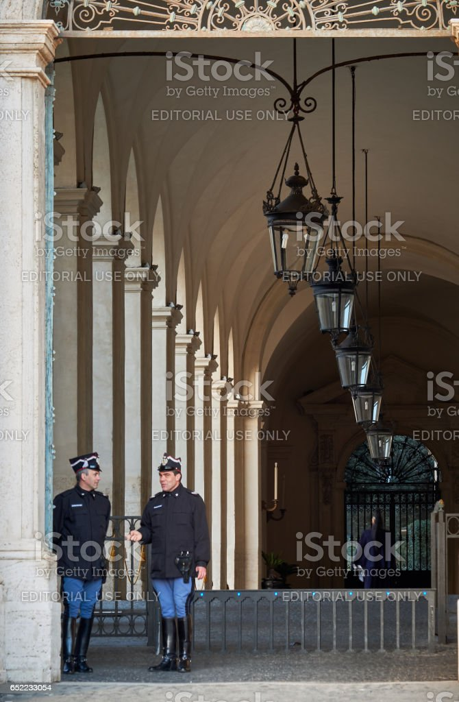 Officers talk by Quirinale Palace's main entrance stock photo