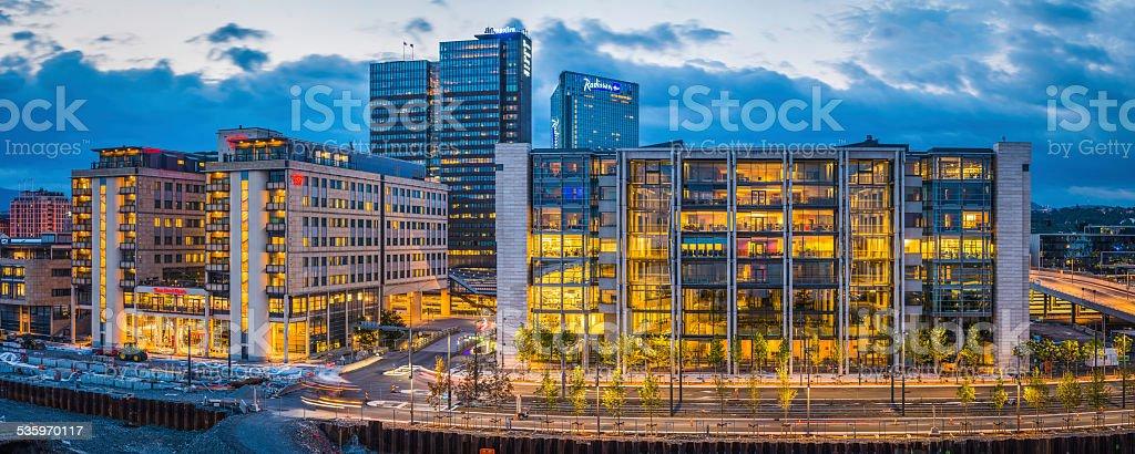 Offices hotels and modern highrises illuminated at dusk Oslo Norway stock photo