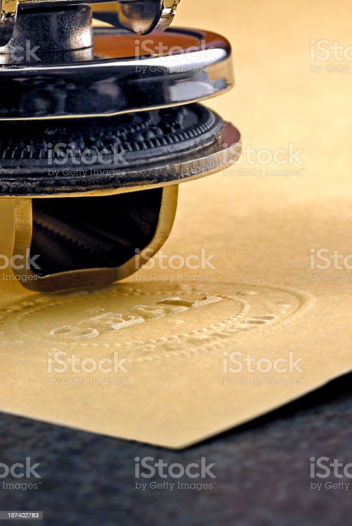 Official Corporate or Notary Raised Seal Embosser and Parchment Paper stock photo