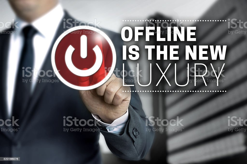 offline is the new luxury concept touchscreen stock photo