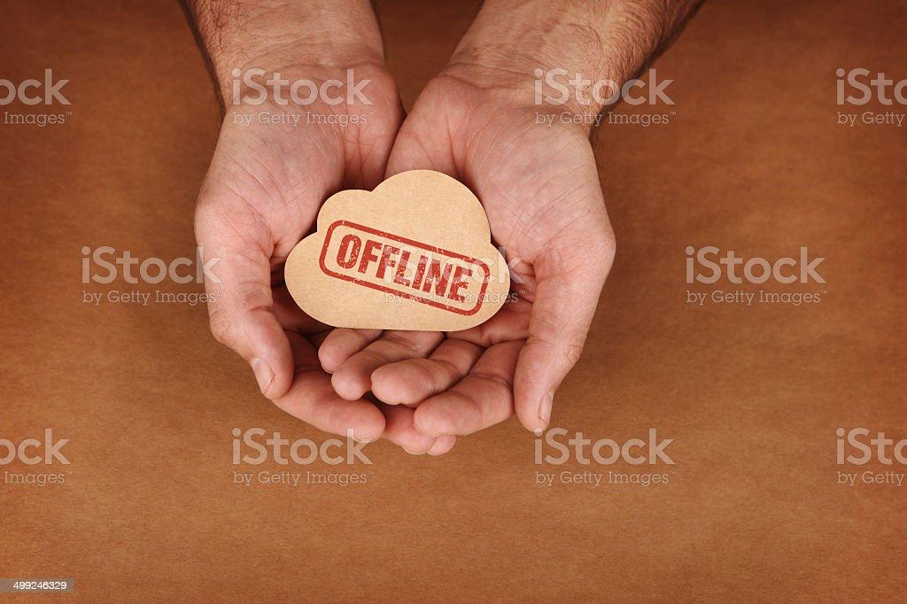 Offline Stamped on Brown Paper Cloud in Hands stock photo