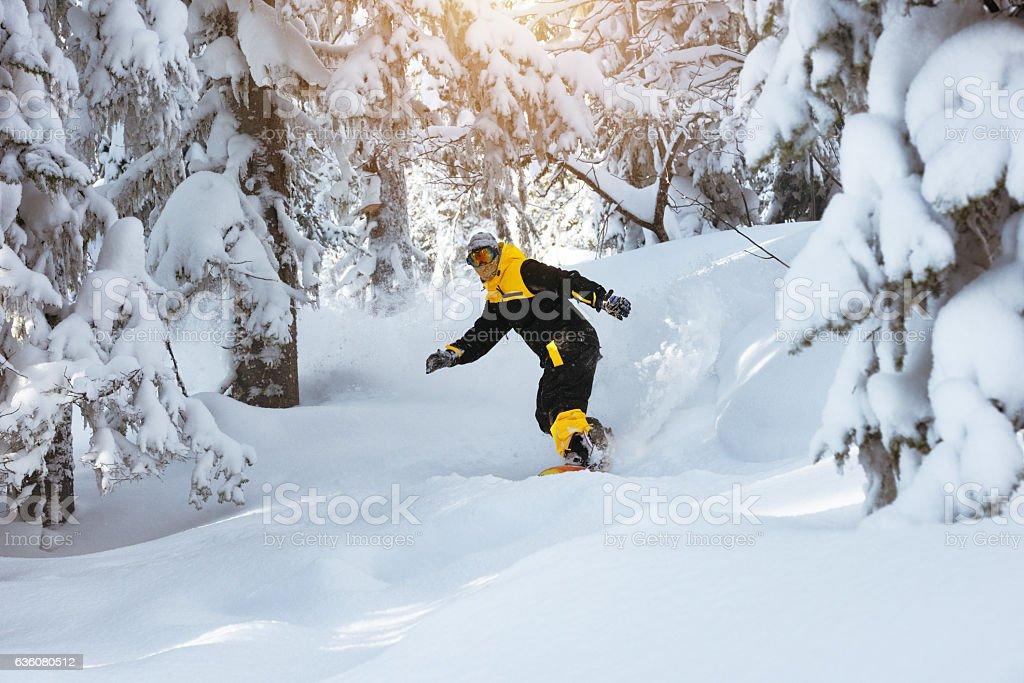 Off-piste riding snowboarding ski snowboarder stock photo