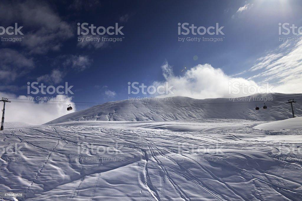 Off-piste ski slope and gondola lift royalty-free stock photo