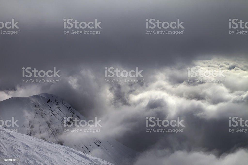 Off-piste slope and snowy rocks in bad weather. Georgia, ski resort...