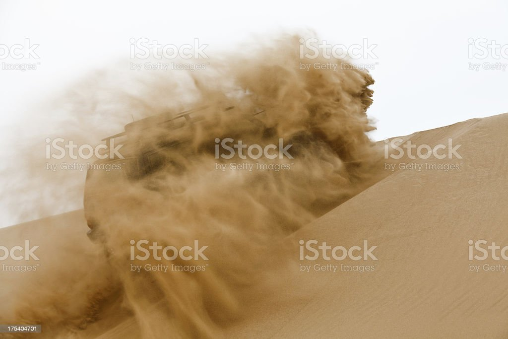 Off-road car going up the sand dune stock photo