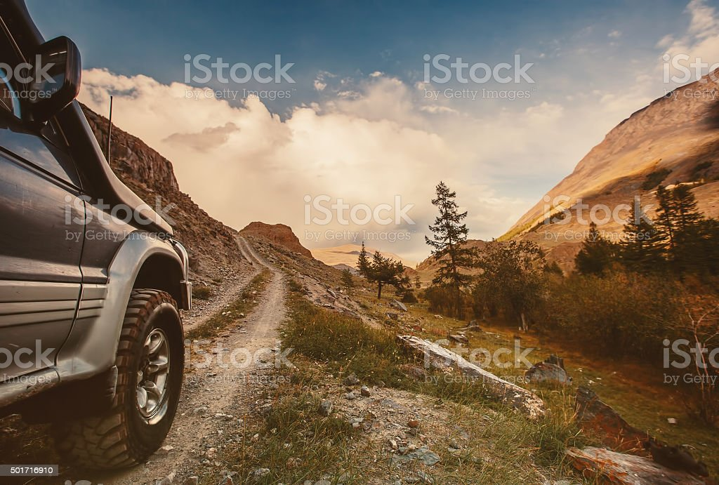 Off-road car on mountain road stock photo