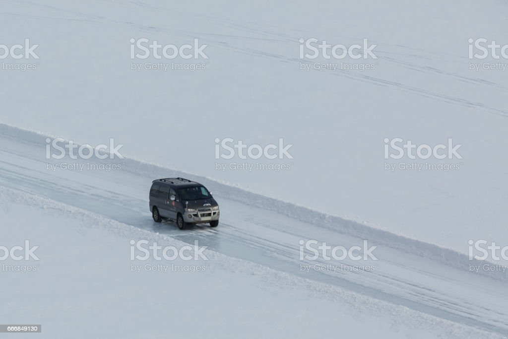 Off-road car rides on ice of Lake Baikal stock photo