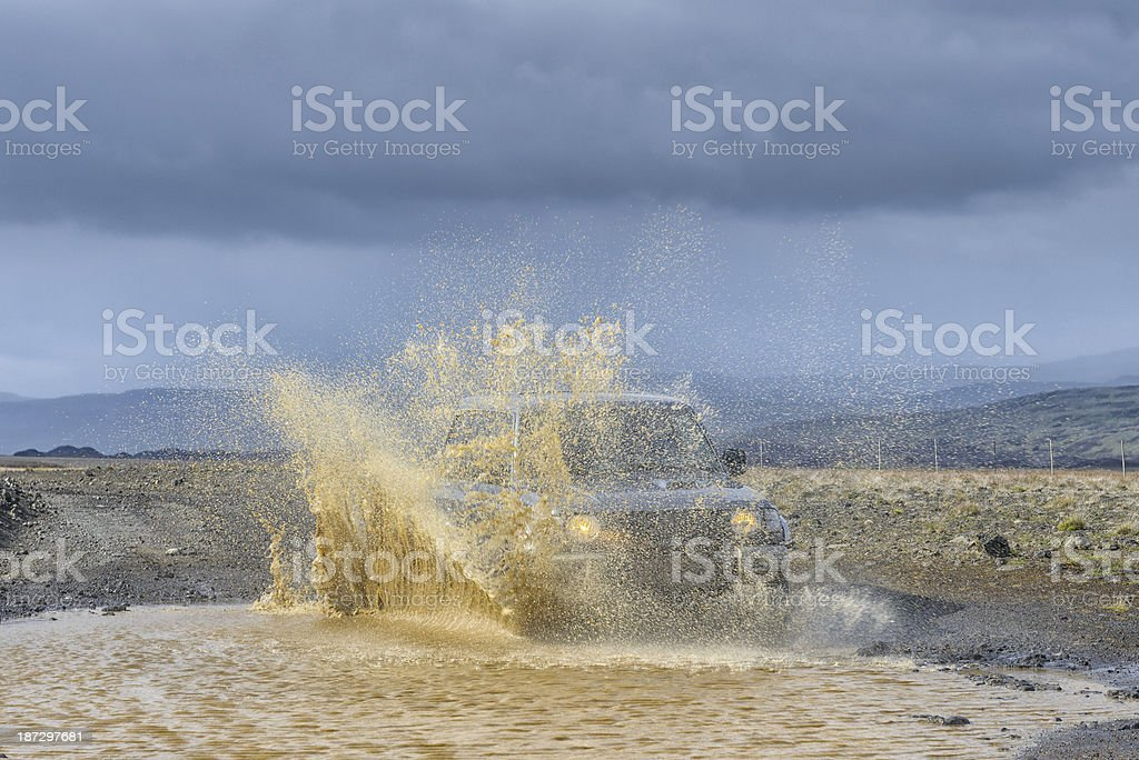 Offroad driving through a river in rural Iceland royalty-free stock photo