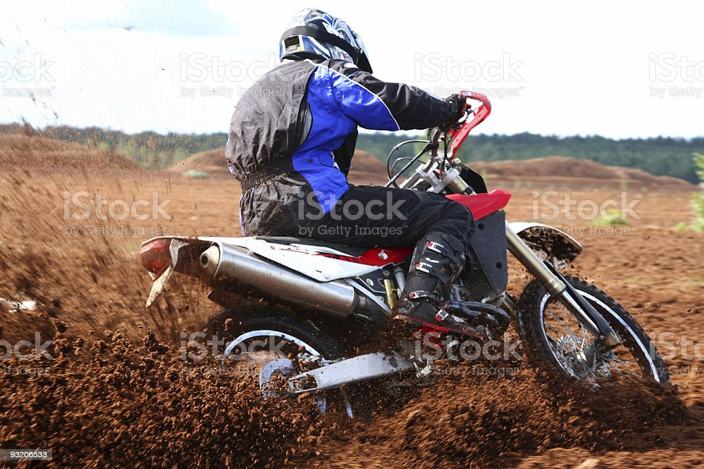 Off-road motorbike cornering in dirt royalty-free stock photo