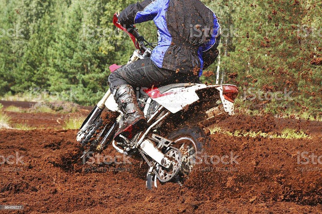 Off-road motorbike cornering in dirt stock photo
