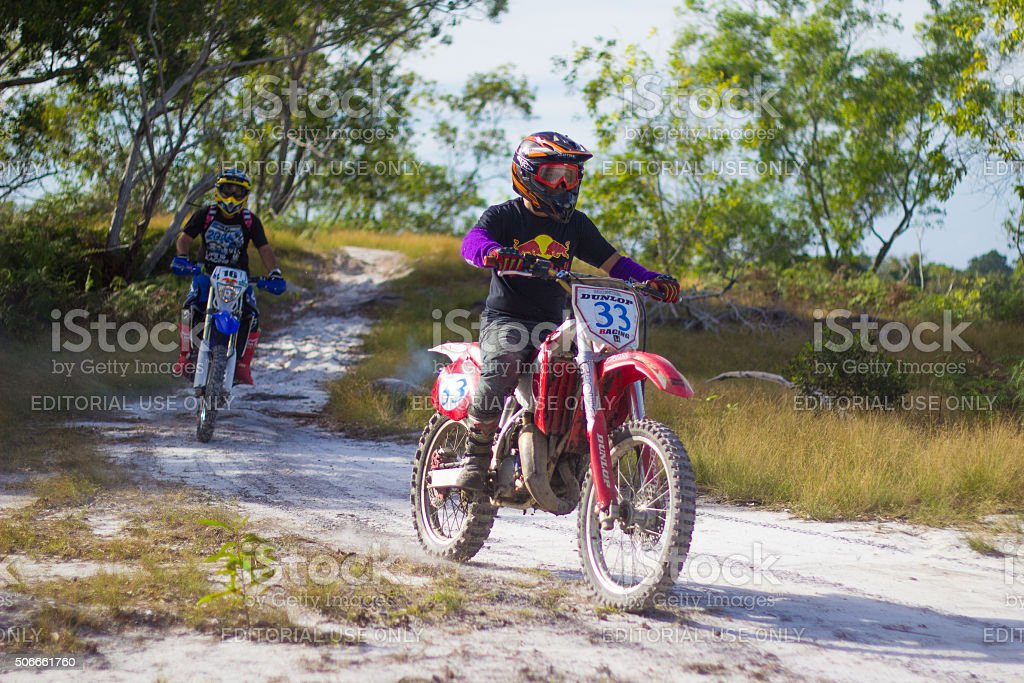 Off-road motorcycle riders trains in the Tg Kubung, Labuan. stock photo