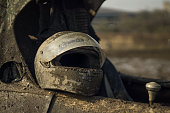 Offroad racer's helmet covered in mud
