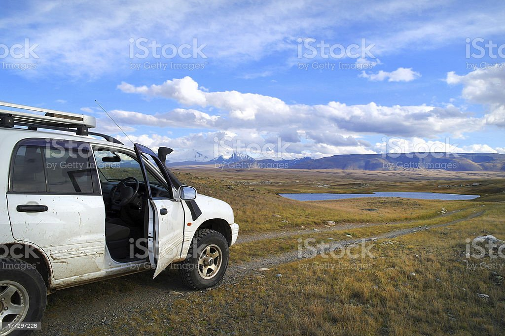 Off-road tourists car on famous mountain Plateau Ukok, Altai, Ru stock photo
