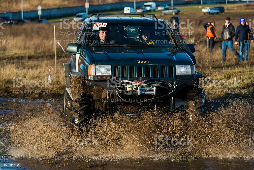 Off-road vehicle brand Jeep Cherokee   overcomes the track stock photo
