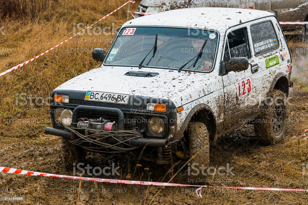 Off-road vehicle brand VAZ  (No. 123) overcomes the track stock photo